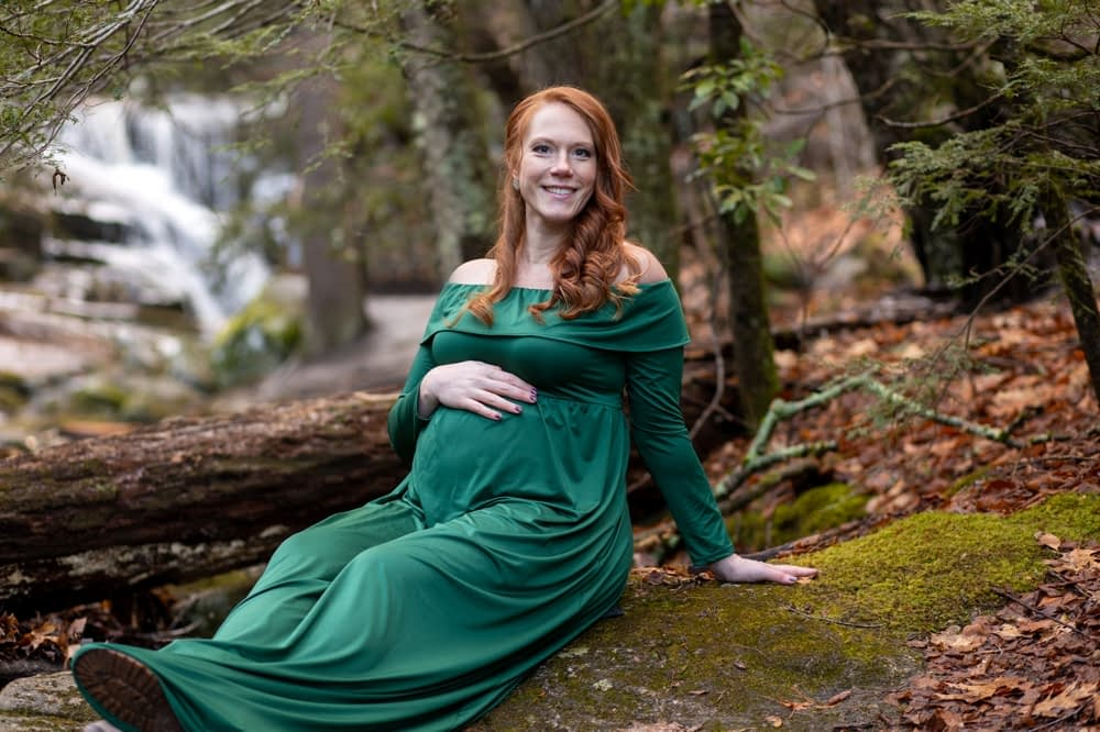 pregnant woman posing in front of enders falls
