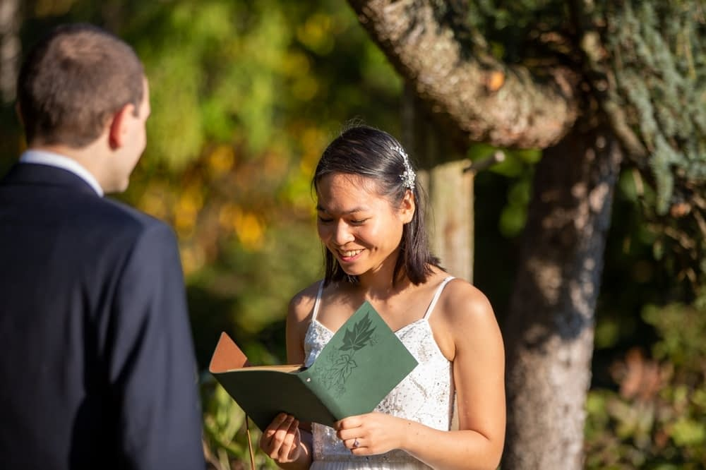 bride reading vows in elopement at elizabeth park